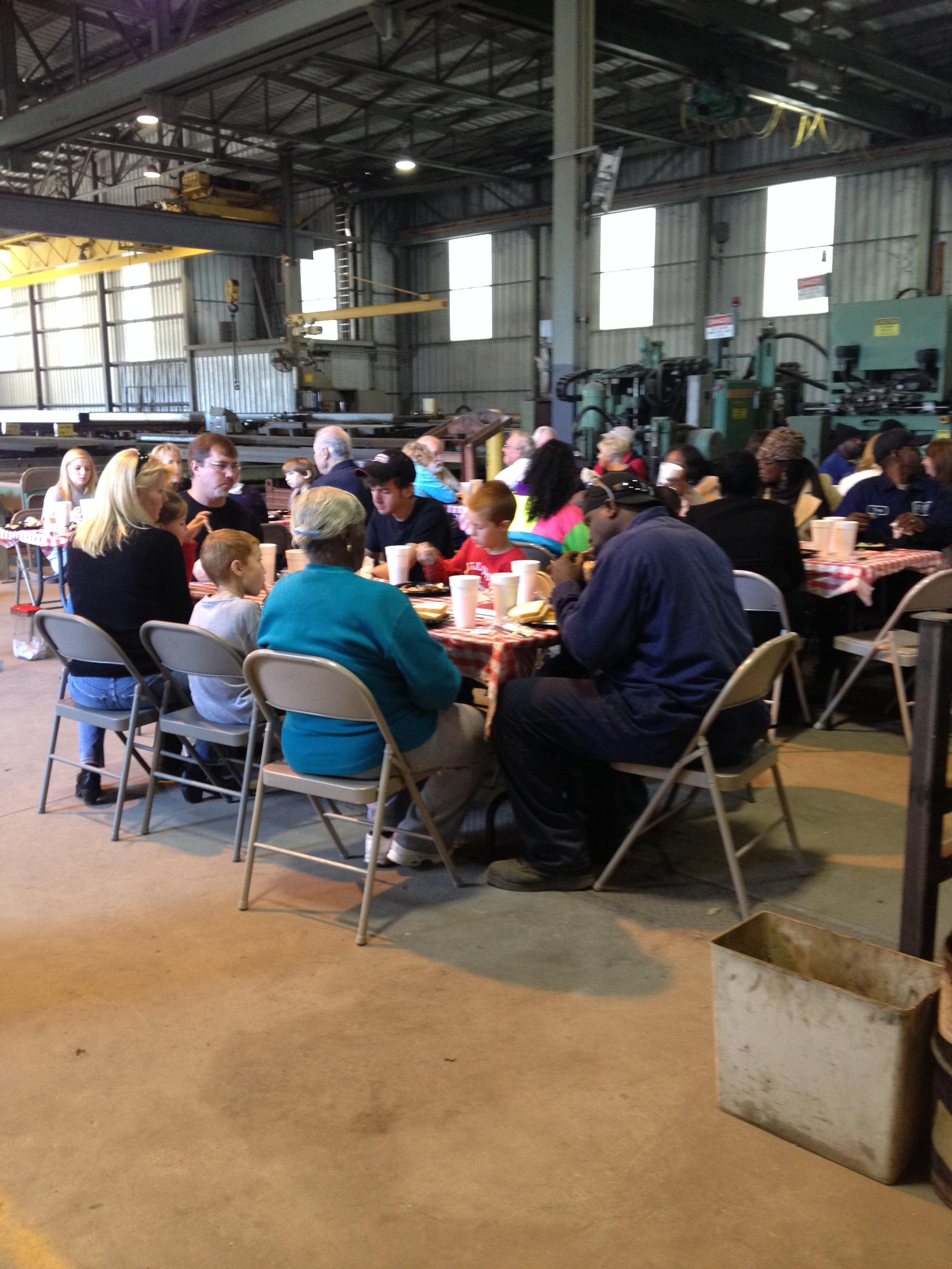 Macuch Steel employees enjoying BBQ catered by Sconyers Bar-B-Que